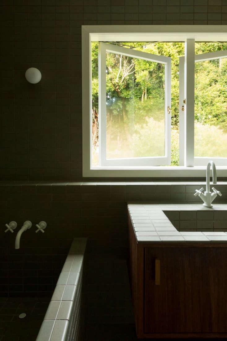 The bath faucet is the Dornbracht Tara Trim Lavatory Mixer in matte white.