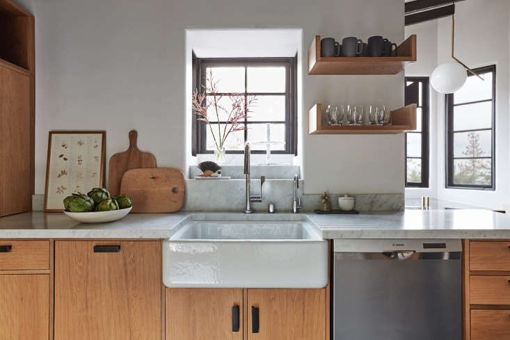 A dishwasher is conveniently located next to the sink in Kitchen of the Week: In Los Feliz, A Moody, Romantic Spanish Modern Update.Photograph byLaure Joliet.