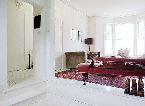 The sitting room was originally painted inWimborne White by Farrow & Ball.