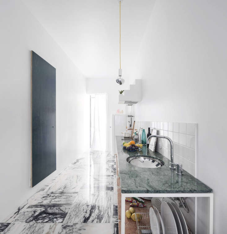 The kitchen is a custom Fala design with countertops of green and pink Portuguese marble.