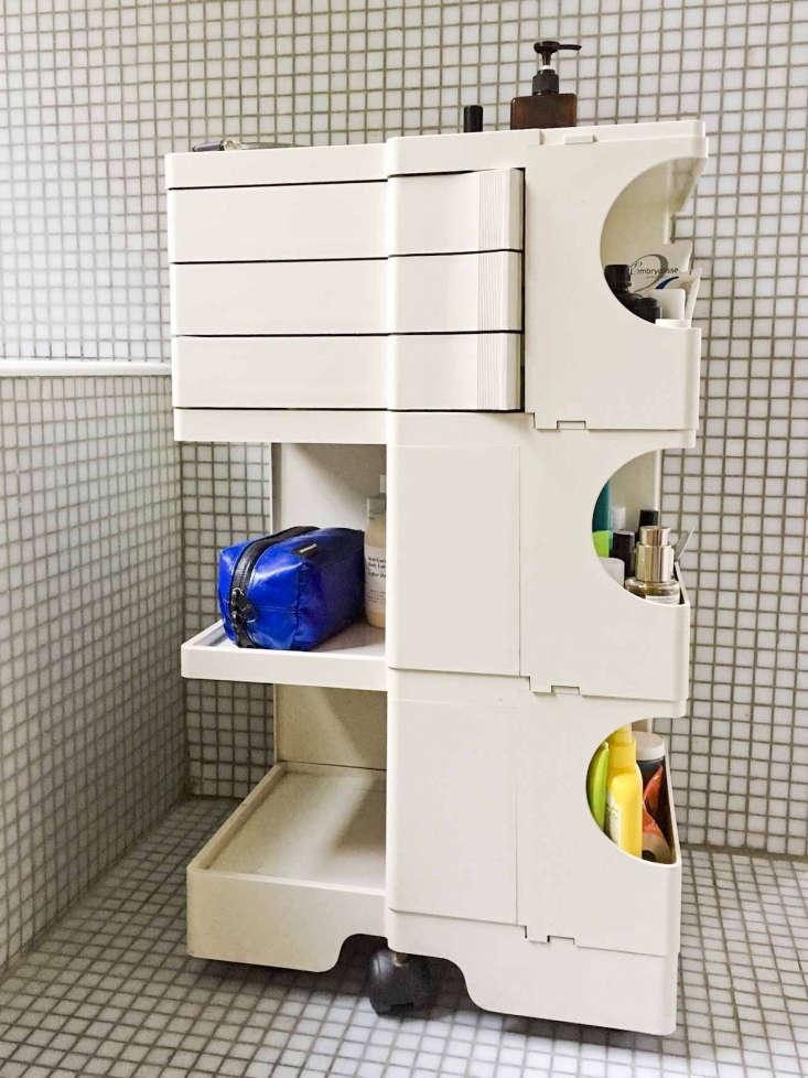 Photographer Marie Hennecharts DIY Parisian Studio Apartment Makeover Art cart used for bathroom toiletry storage in photographer Marie Hennechart's Paris studio apartment