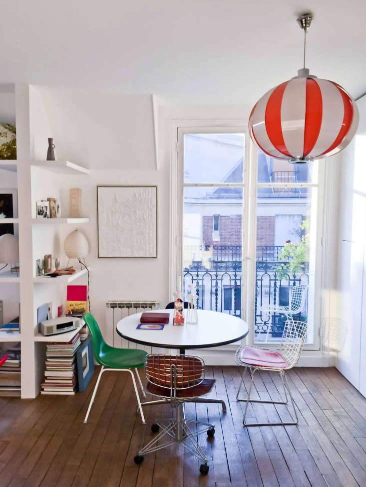 Photographer Marie Hennecharts DIY Parisian Studio Apartment Makeover A space saving circular George Nelson table is surrounded by a sampling of Marie&#8\2\17;s chair collection, including a green Eames chair (&#8\2\20;from a cafeteria in the Pigalle that closed&#8\2\2\1;), a steel and leather Renzo Piano library chair salvaged from the Pompidou, and aBertoia Side Chair with &#8\2\20;a very vintage orange leather cover.&#8\2\2\1;