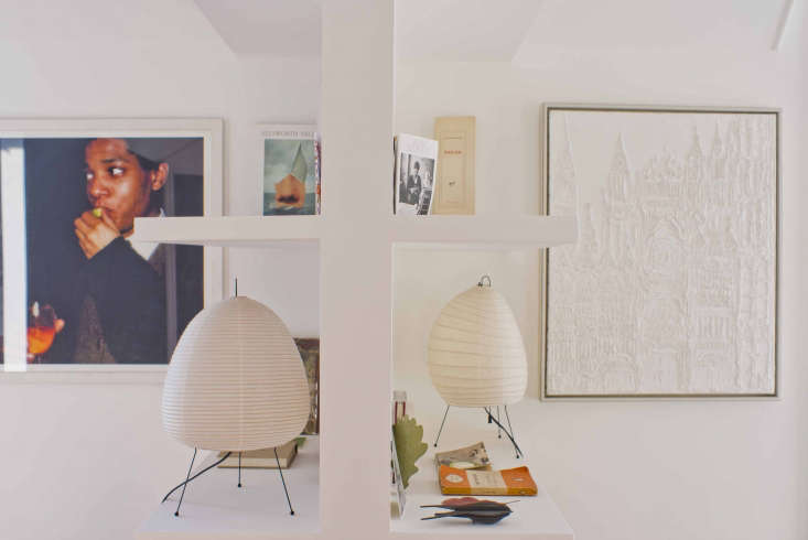 Photographer Marie Hennecharts DIY Parisian Studio Apartment Makeover Noguchi Akari Lightspack flat–Marie brought them home from a trip to Japan more than \20 years ago.