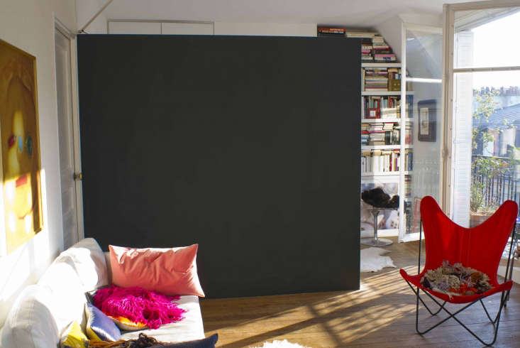 Photographer Marie Hennecharts DIY Parisian Studio Apartment Makeover Marie&#8\2\17;s bedroom is screened off by a partition that she paints a different color every few years. It&#8\2\17;s currentlya matte deep green that&#8\2\17;s almost black from Emery et Cie of Belgium.