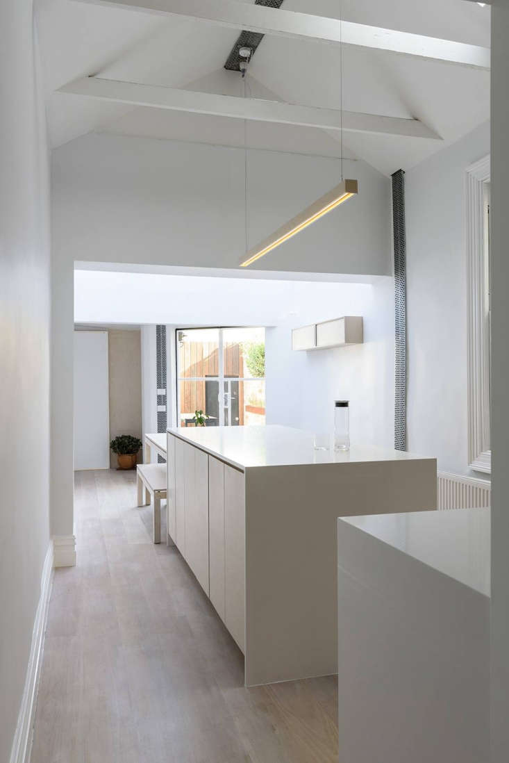 In the narrow, open-plan kitchen and dining, there&#8