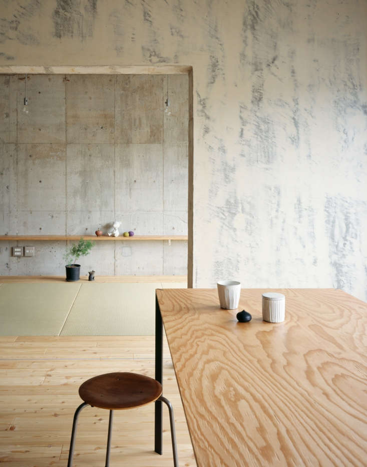 In Setagaya Apartment in Tokyo by Naruse Inokuma Architects, a highly figured plywood panel has been used for a dining room table. Photograph by Masano Nishikawa.