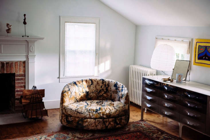 farmhouse mod: in front of the master bedroom fireplace, a milo baughman circul 17