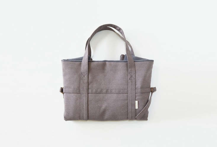 the dog travel bag (\$\155), shown in gray, is made of dirt  and water repellen 11