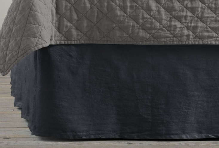 The Garment-Dyed Linen Bed Skirt in charcoal is $65 to $5, depending on size at Restoration Hardware.