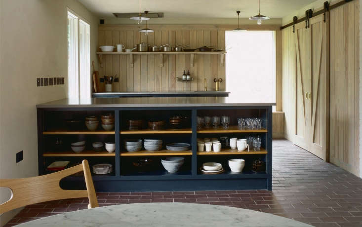 open shelving, painted blue, provides a backdrop for glassware and tableware. t 18