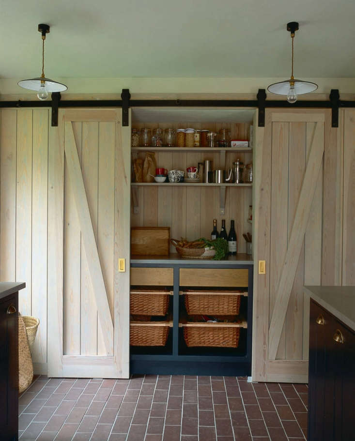 Steal This Look A Piggery Turned Kitchen Custom Larder Included The custom larder behind sliding barn doors.