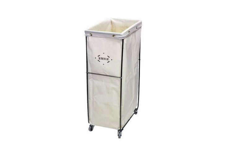 the steele narrow elevated laundry basket has a sturdy steel frame and a remova 18