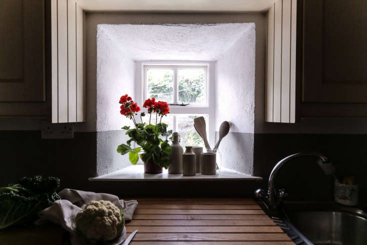 windows in the cottage are small and deep. this one displays the couple&#8\ 18