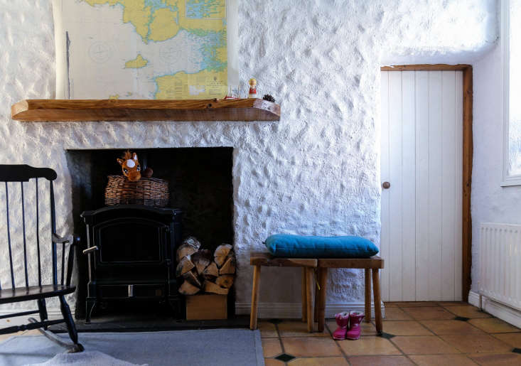 the hearth is inset with a woodburning stove.when jo anne was pregnant, they  12