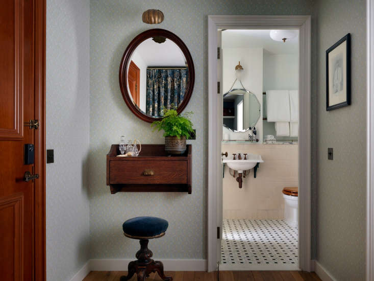 a vintage style wall mounted desk acts as a vanity. 12