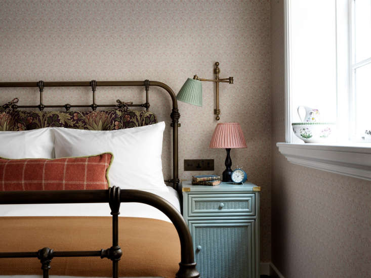 in one of the smallercrash padrooms: bespoke floral wallpaper and two bedsi 11
