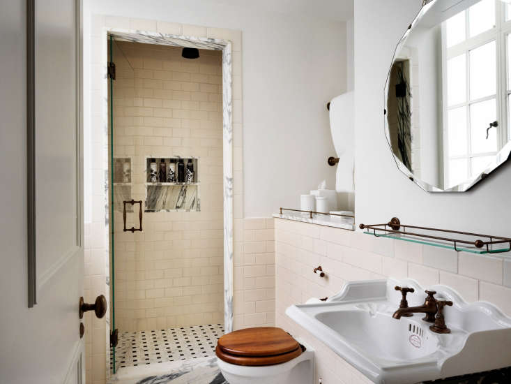 the bathroom in a crash pad guest room features a walk in shower, marble detail 14