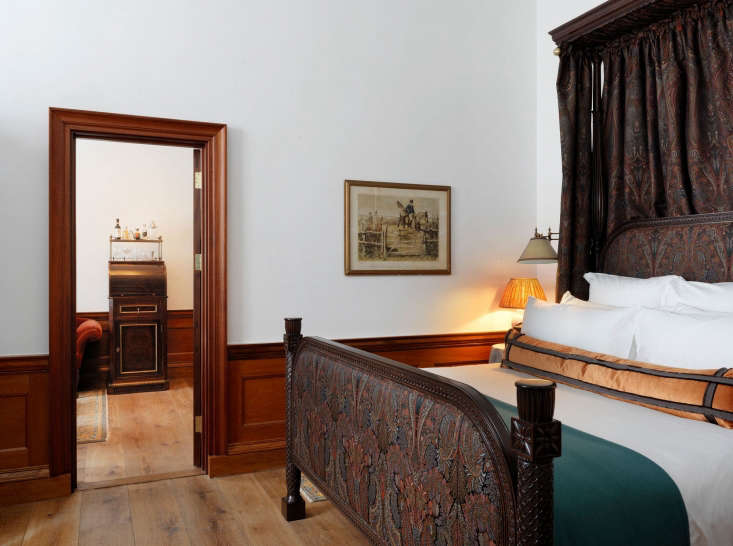 the more stately heritage suite features a canopy bed, a seating area with a &a 15