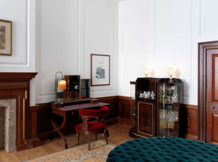another suite evokes a vintage office with dark wood paneling and a desk chair  18