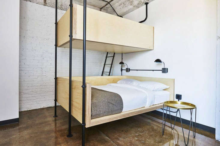 floating built in bunkbeds are supported by steel piping. 14