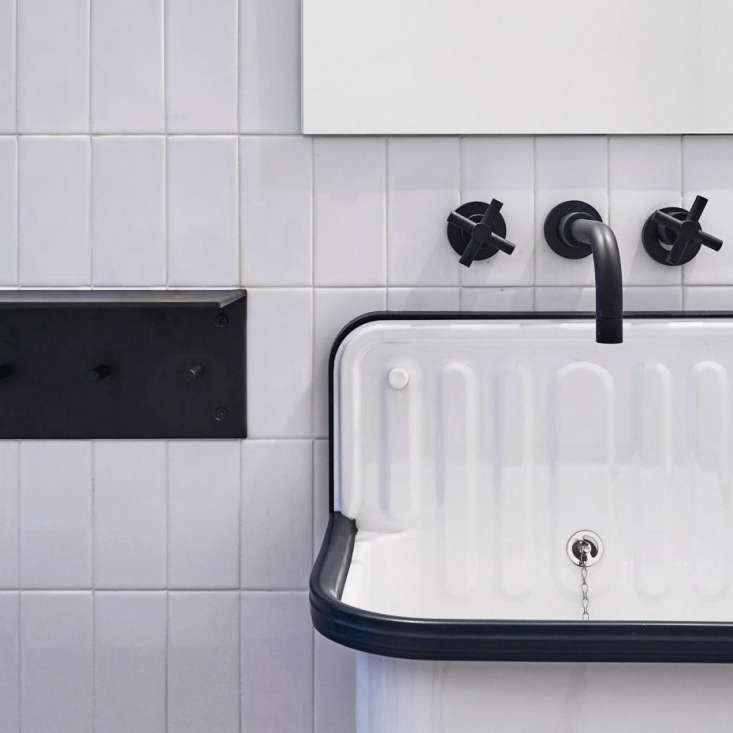 the guest bathrooms have utilitarian alape bucket sinks from germany with black 16