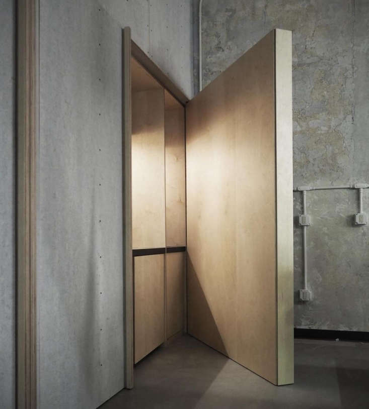 built in (and hidden) lobby wall storage made from plywood. 17