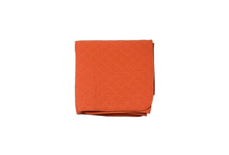 Steal This Look CampStyle Bedroom with Bold Color The Utility Canvas Throw Blanket in orange is made of garment dyed cotton quilted canvas; \$\135 at Utility Canvas.