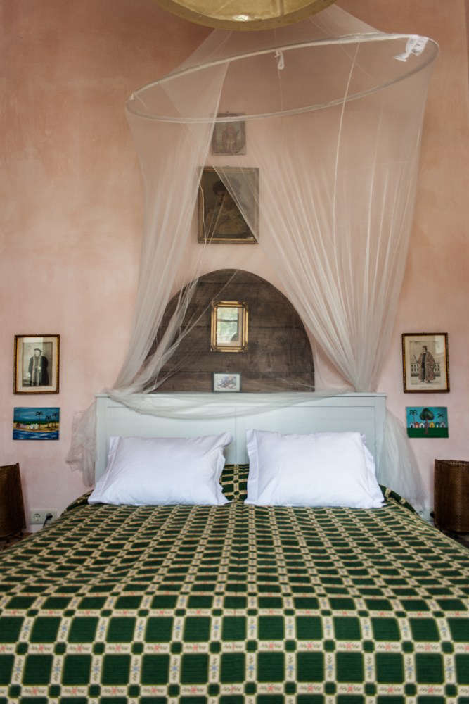 Another Double Superior room in shades of green and blush pink, net canopy included.