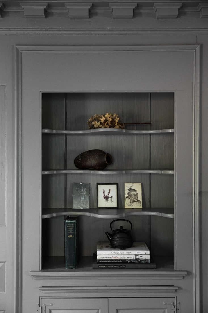 a built in hutch, painted gray, holds objets d&#8\2\17;art and a dried hydr 21