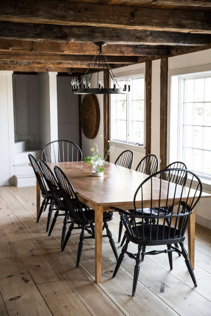 the dining room, with black spindle back chairs and original wide plank floorin 15
