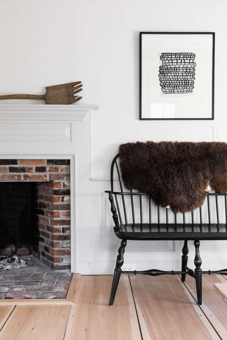 beside another fireplace, a black bench fromwindsor chairmakers in lincoln, m 20