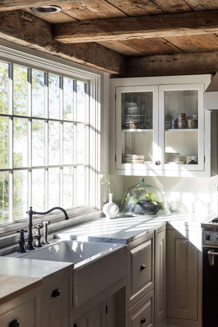 in the kitchen, light filters in through the original paned windows. 11