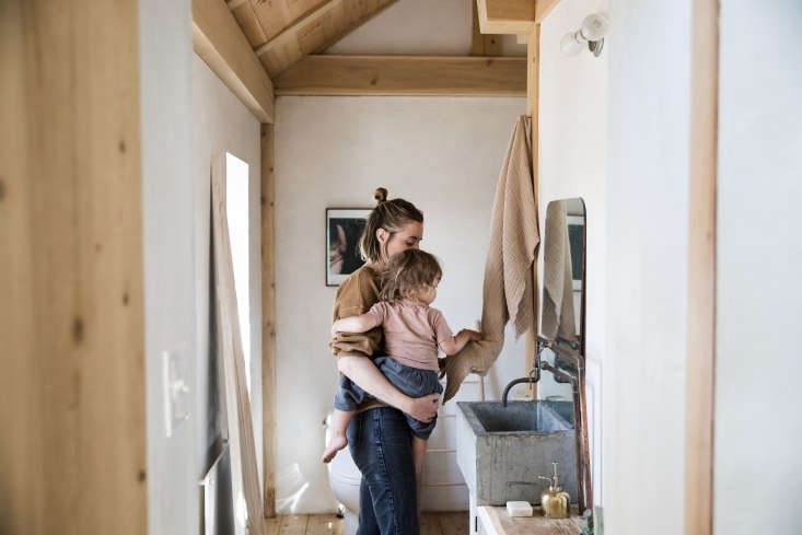 o&#8\2\17;rourke and son diogo in the bathroom, with an exposed pipe faucet 23