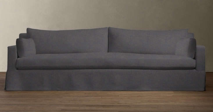 The Belgian Track Arm Slipcovered Sofa in charcoal starts at $