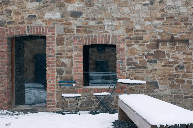 single pane glass windows set into the original brick and stone. 24