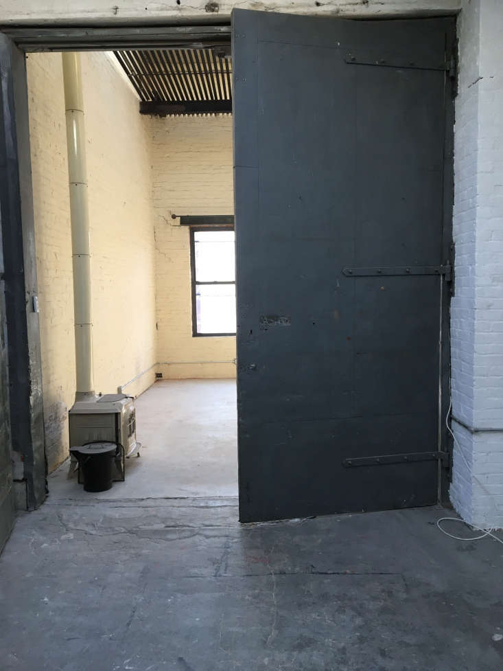 The freight elevator turned dining room, before. Photograph courtesy of Cook Space.