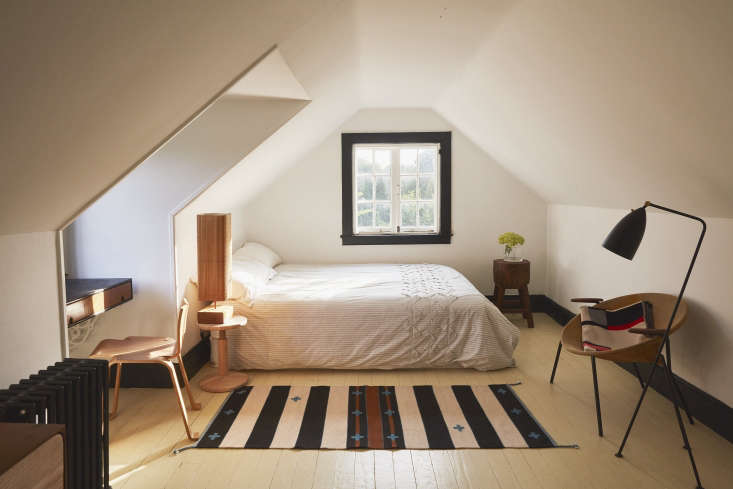 In the attic bedroom, Valentin is still experimenting with the elements: The pale yellow floors may change to another color and the Pendleton rug is a temporary fix. The table lamp was sourced by designer friend Esteban Arboleda in a flea market in Bogotá, Colombia; it&#8