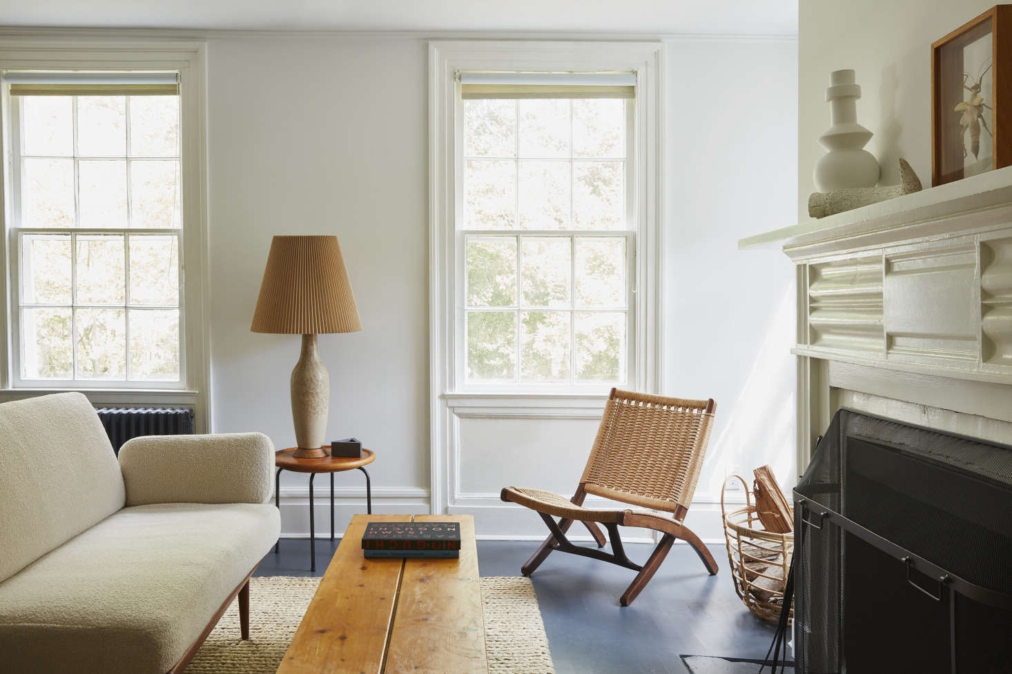 Simple roller shades in A Colonial House in Bellport with Uncommon Style from French Designer C. S. Valentin. Photograph by Jonathan Hokklo.