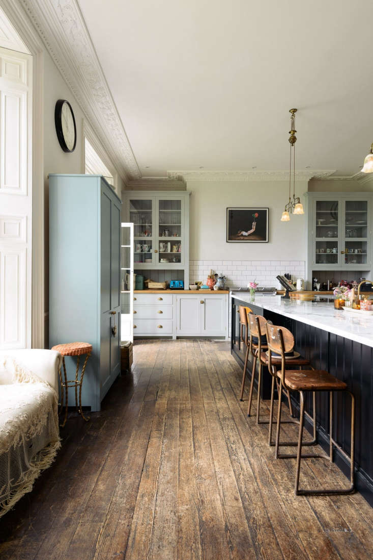 The floors are original to the country house, and the walls are painted in Farrow & Ball&#8