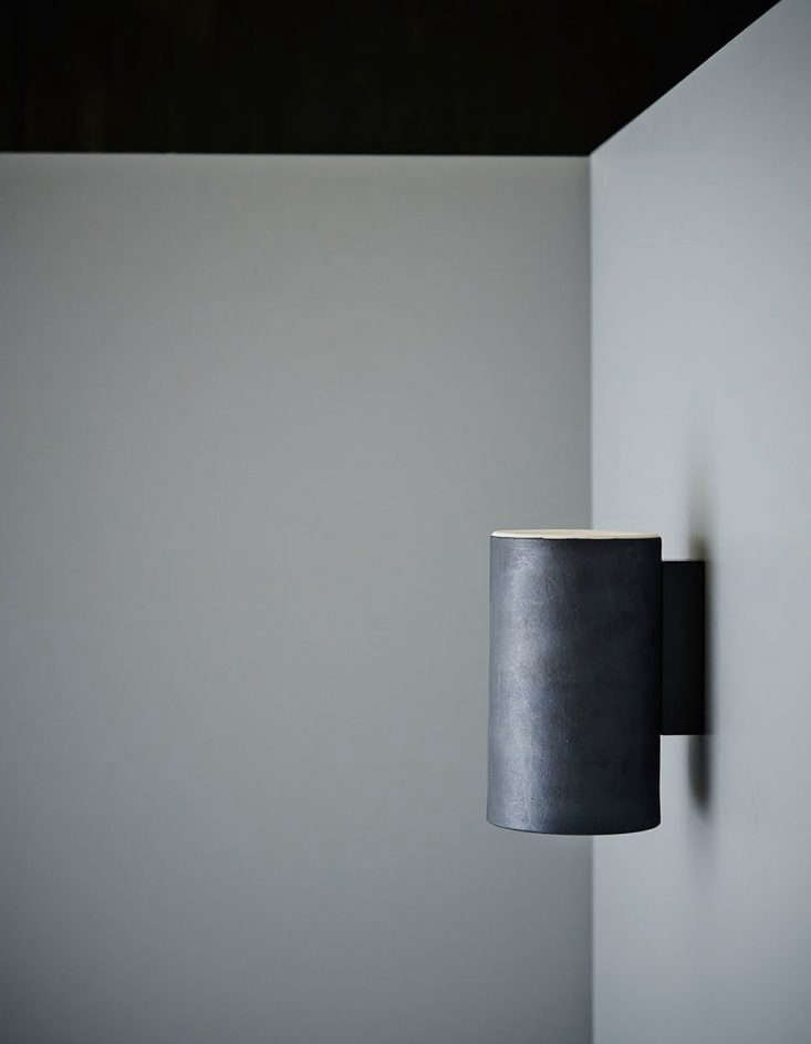 TheEarth Wall Light in a charcoal glaze finish.