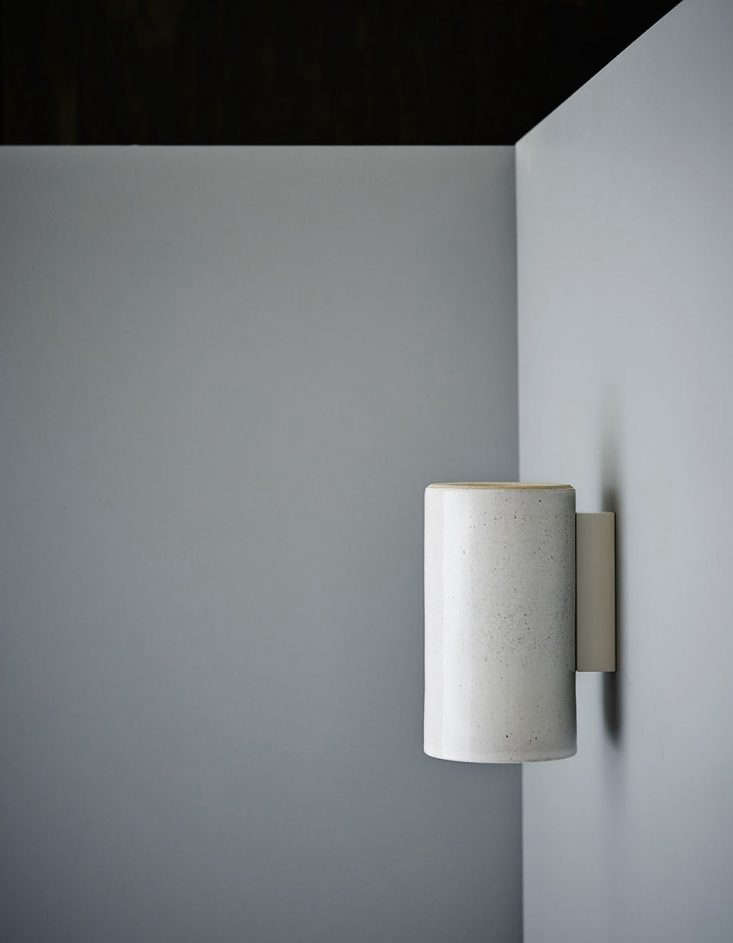 TheEarth Wall Light in speckled white.