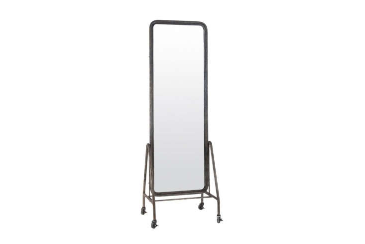 Source a vintage industrial floor mirror on wheels or something similar like the Black Inclined Free Standing Floor Mirror on Wheels for £367.50 at Em Home.