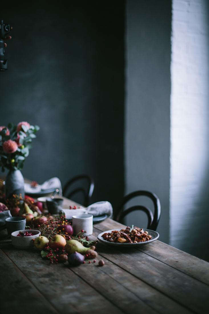 a dark fall tablescape by flores and our food stories. 10