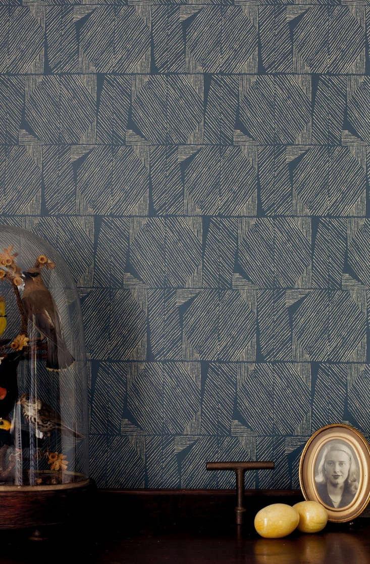 lapel wallpaper in navy and cream (\$65 per yard). 19