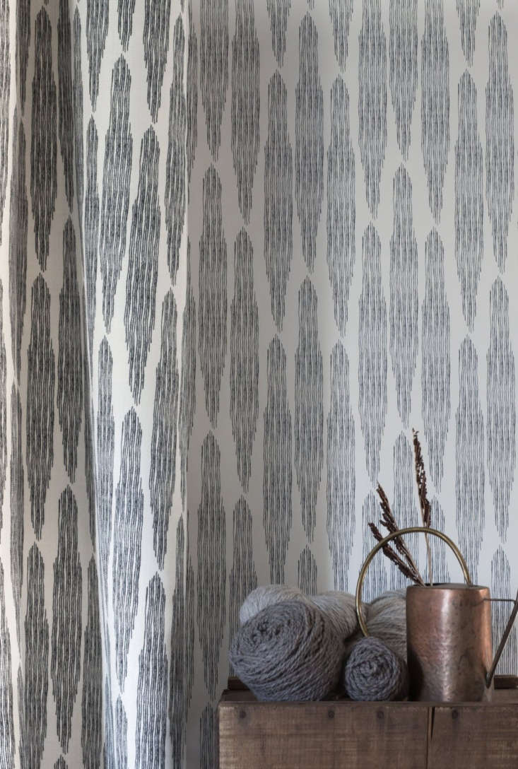 pines wallpaper(\$65 per yard), shown here in midnight, is reminiscent of col 18