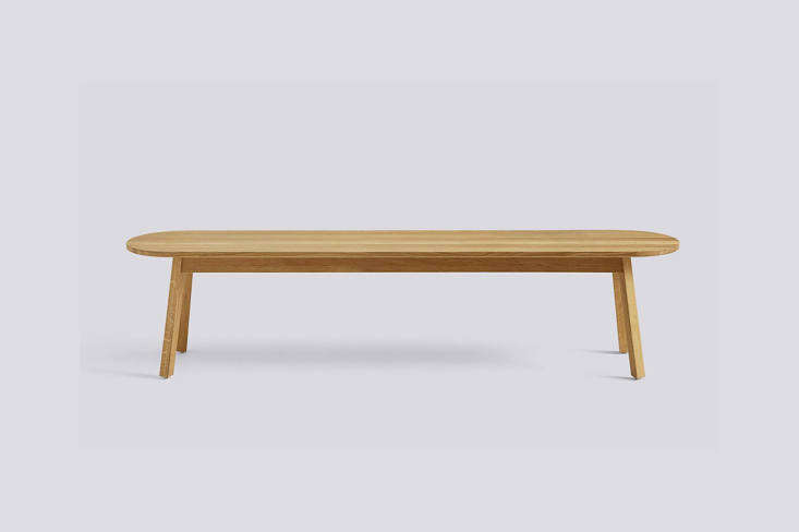 The Prytzes use an Ikea Sinnerlig Cork Bench (no longer available) designed by Isle Crawford as their coffee table. For something similar, the oak wood Hay Triangle Leg Bench comes in two sizes; from $loading=
