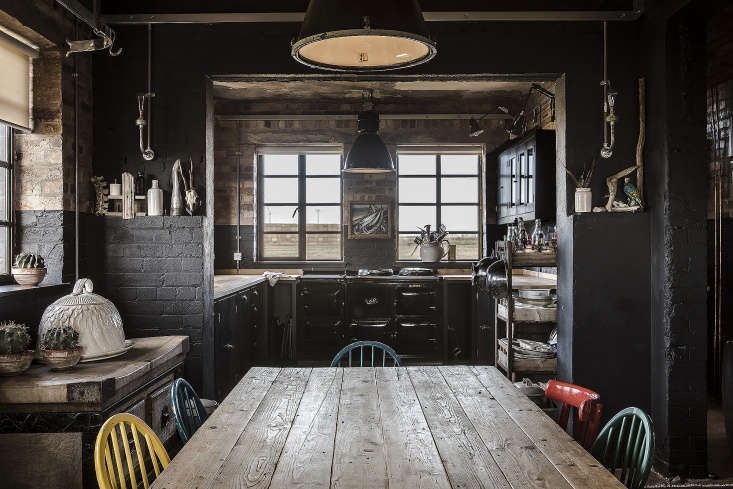 For a moodily cohesive effect, the couple extended theOff-Black to parts of the brick walls.