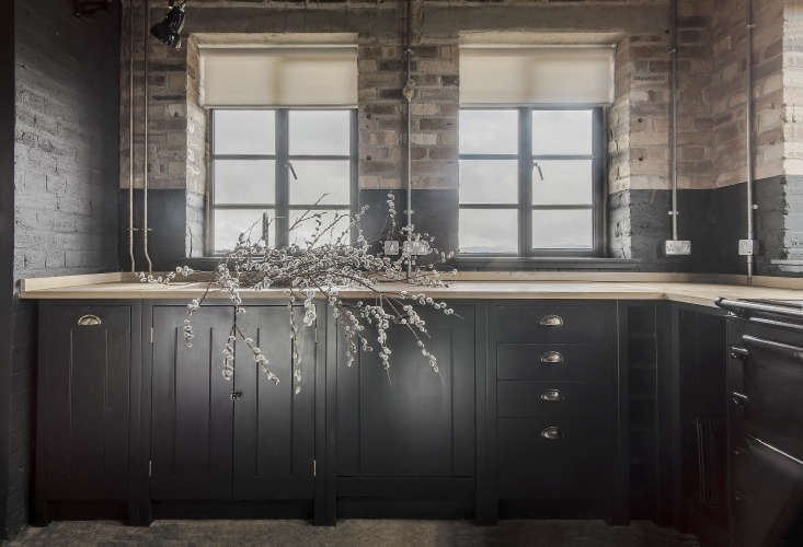The kitchen is fitted with British Standard poplar-faced cupboardsin Farrow & Ball&#8