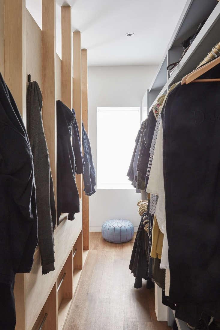 A galley-style closet with custom shelving painted Benjamin Moore Marina Gray.