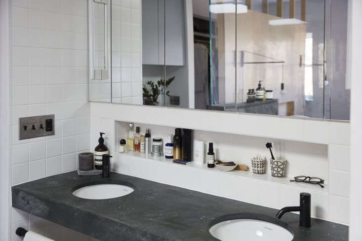 Alcoves are a theme. Here, a lineup of bath products sits above a pair ofDuravit Architect Basins with Vola HVloading=
